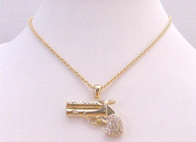 Самый маленький в мире золотой пистолет стоит $60 тыс.