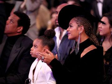 Бейонсе и Джей-Зи с дочкой