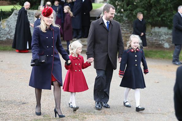 Пітер і Отем Філіпс з дітьми