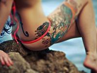 Татуировка на бедре